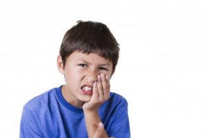 boy with mouth pain