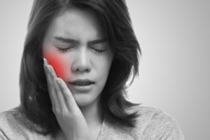 woman with root canal pain